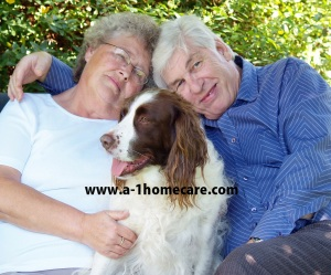 Couple and their dog english spaniel having a cuddle